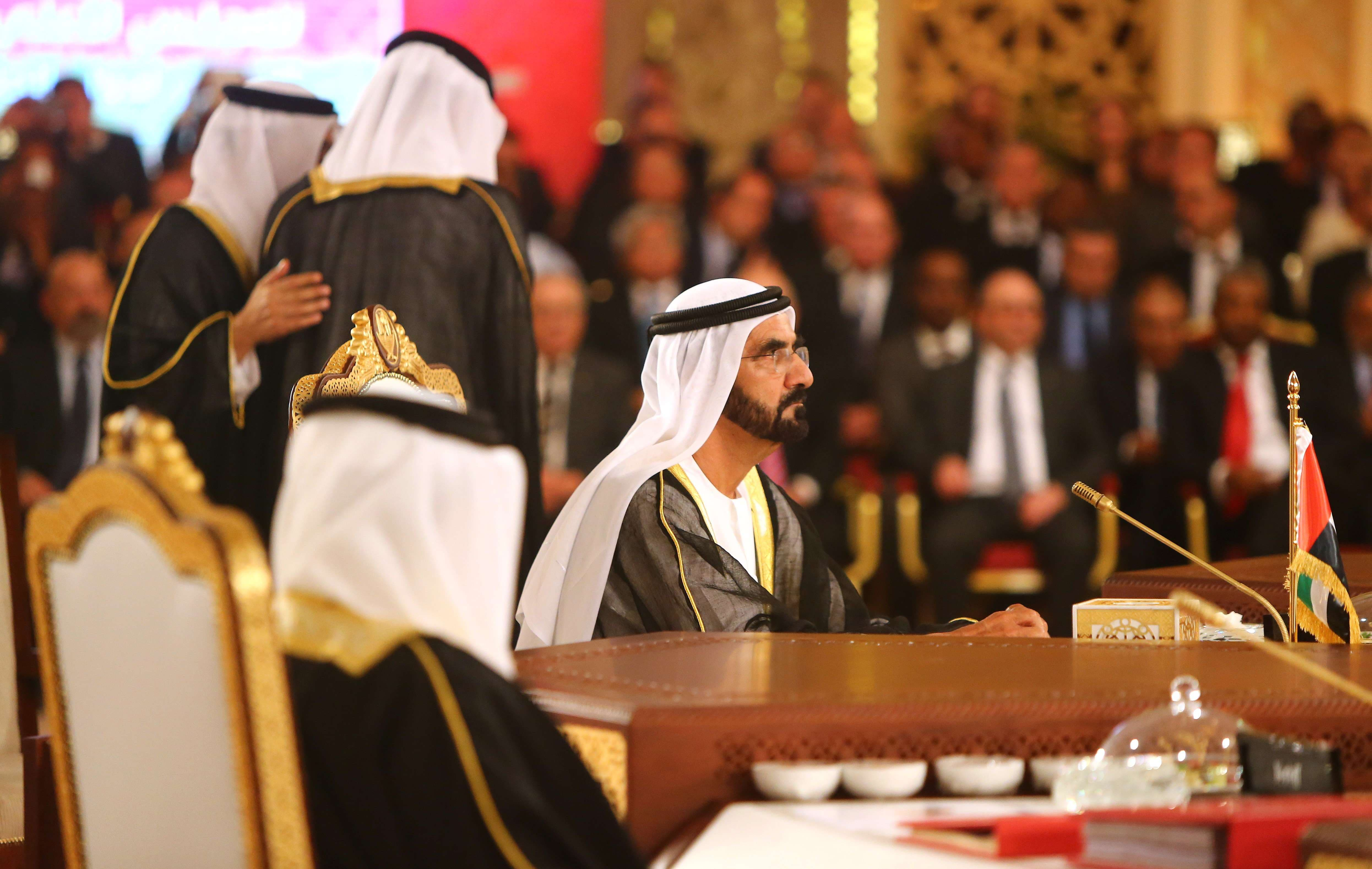 Sheikh Mohammed Bin Rashid al-Maktoum (C), ruler of Dubai looks on during the Gulf Cooperation Council (GCC) summit in Doha on December 9, 2014. (AFP)