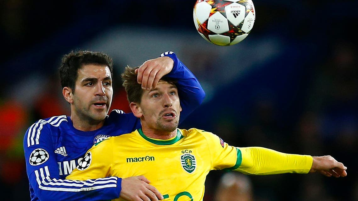 Chelsea's Cesc Fabregas (L) challenges Sporting's Adrien Silva during their Champions League soccer match at Stamford Bridge in London December 10, 2014.  (Reuters)