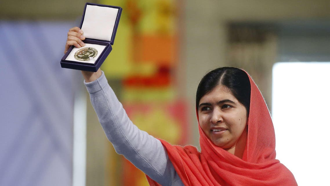 Nobel Peace Prize laureate Malala Yousafzai displays her medal during the Nobel Peace Prize awards ceremony at the City Hall in Oslo, Norway, on December 10, 2014. (AFP)
