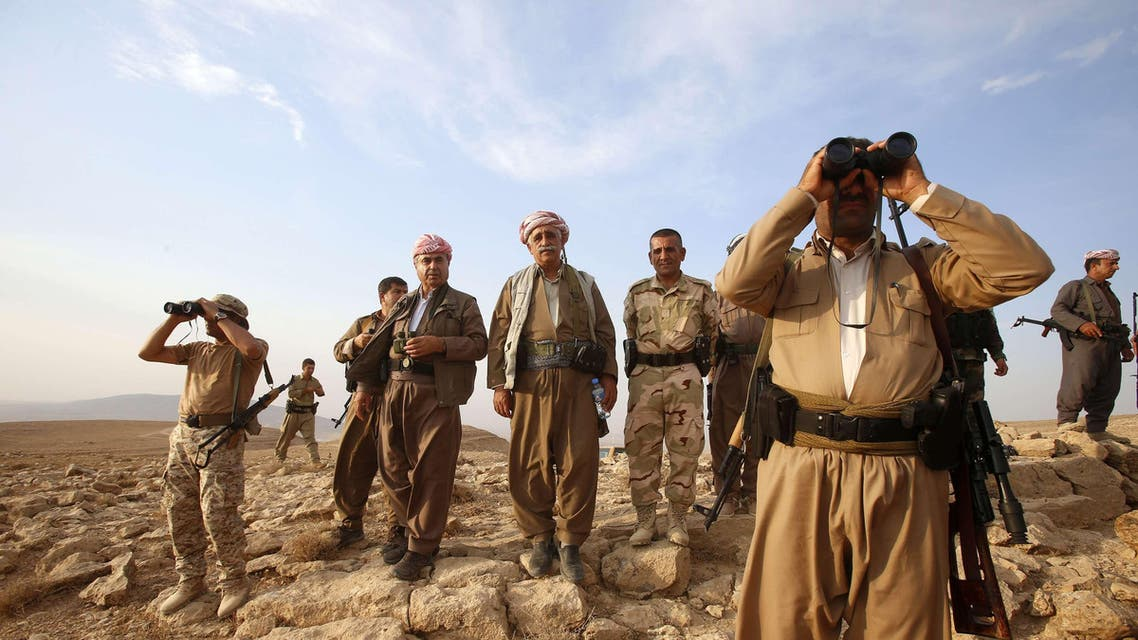 Kurdish Peshmerga forces stand guard near the town of Makhmur, south of Erbil, capital of Iraqi Kurdistan after Islamic State (IS) insurgents withdrew in this August 18, 2014
