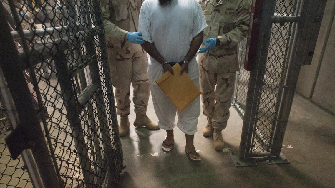 This March 30, 2010 file photo shows US military guards as they move a detainee inside Camp VI at Guantanamo Bay, Cuba. (File photo: AFP)