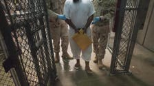 Obama blasts Guantanamo provision as he signs defense bill