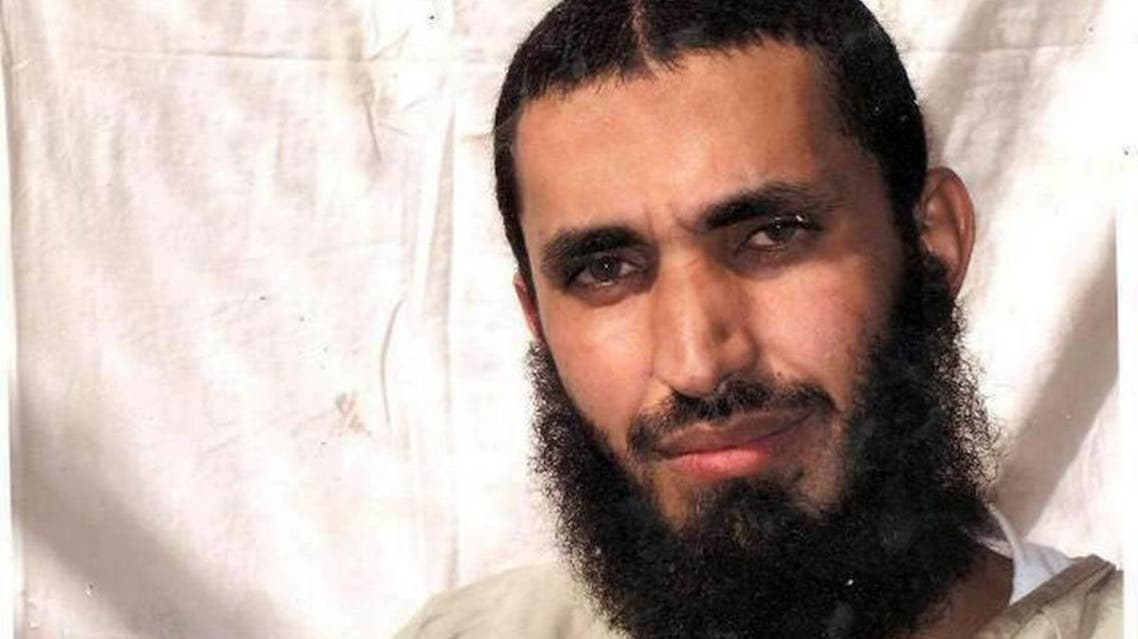 Abdel Malik Wahab al Rahabi is seen here posing for his family somewhere inside Guantánamo in this undated, U.S.-military approved photo taken by the International Red Cross, and furnished to The Miami Herald by his attorney. Courtesy attorney David Remes  Read more here: http://www.miamiherald.com/news/nation-world/world/americas/article1959705.html#storylink=cpy