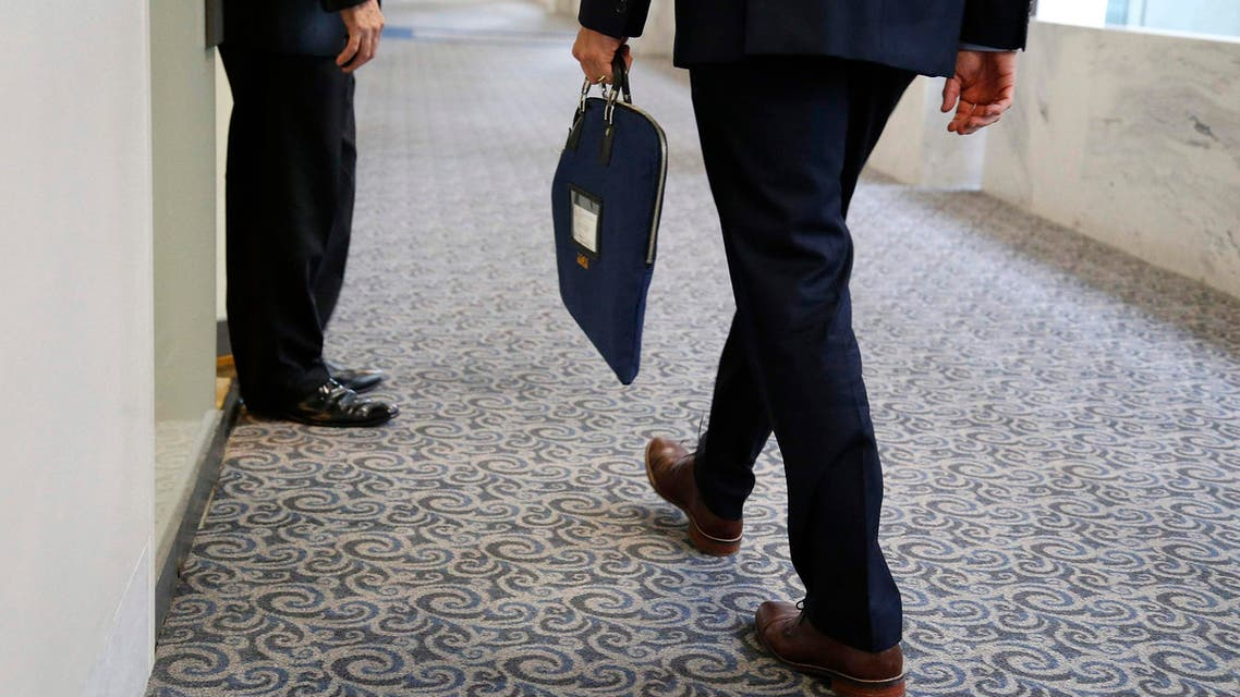 A U.S. Senate Intelligence Committee staff member enters the committee's offices with a secure attache case on Capitol Hill in Washington in this July 31, 2014 file photo.  (Reuters)