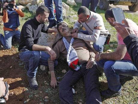 Ziad Abu Ein lying injured after he was in an altercation with Israeli troops. Reuters