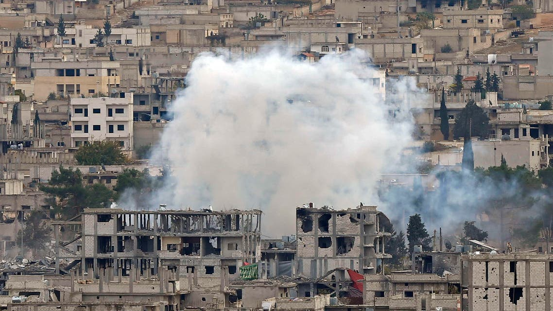 Smoke raises from central Kobani, where buildings have been damaged in fighting between Islamic State militants and Kurdish forces, November 23, 2014. reuters