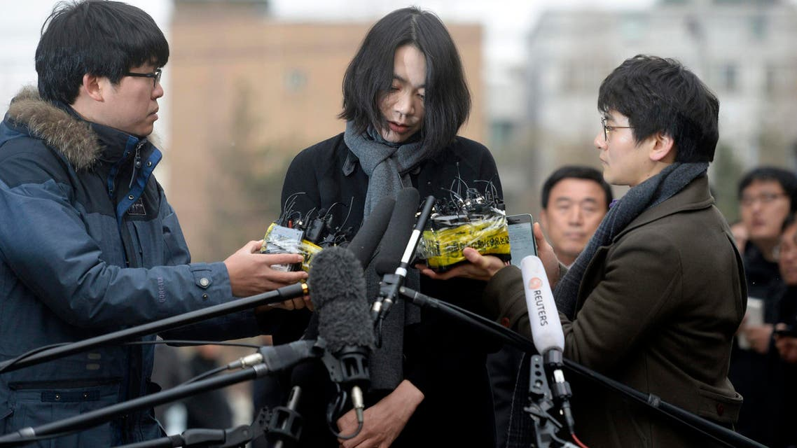 Cho Hyun-ah, also known as Heather Cho, daughter of Korean Air Lines chairman, Cho Yang-ho, appears in front of the media outside the offices of the Aviation and Railway Accident Investigation Board of the Ministry of Land, Infrastructure, Transport, in Seoul December 12, 2014.  reuters