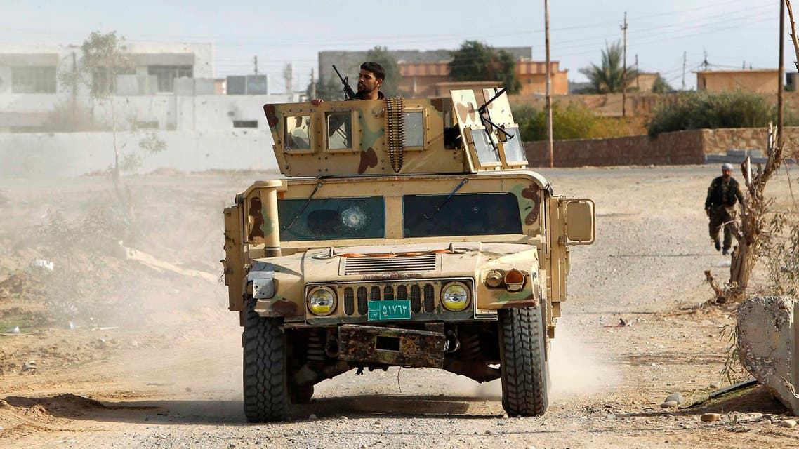 Military vehicles of the Iraqi security forces make their way on the outskirts of Baiji, north of Baghdad, December 8, 2014. (Reuters)