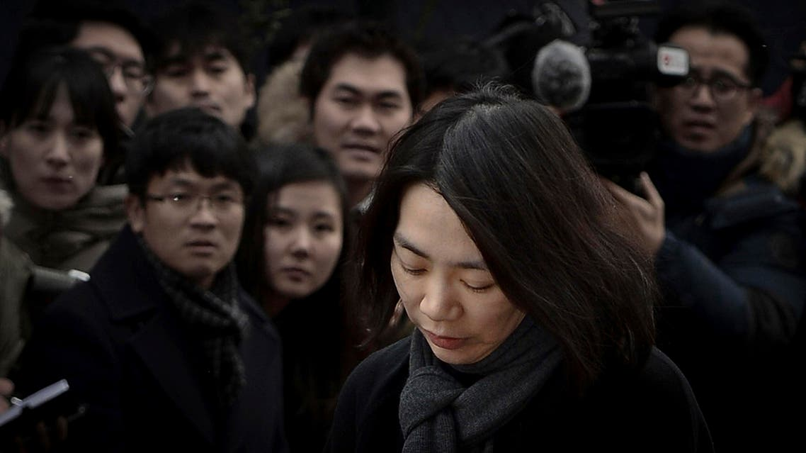 Cho Hyun-ah, also known as Heather Cho, daughter of chairman of Korean Air Lines, Cho Yang-ho, appears in front of the media outside the offices of the Aviation and Railway Accident Investigation Board of the Ministry of Land, Infrastructure, Transport, in Seoul December 12, 2014. (ReuterS)