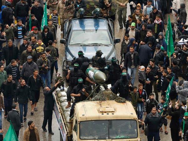 حماس تستعرض عسكرياً وعباس يتهمها بعرقلة اعمار غزة