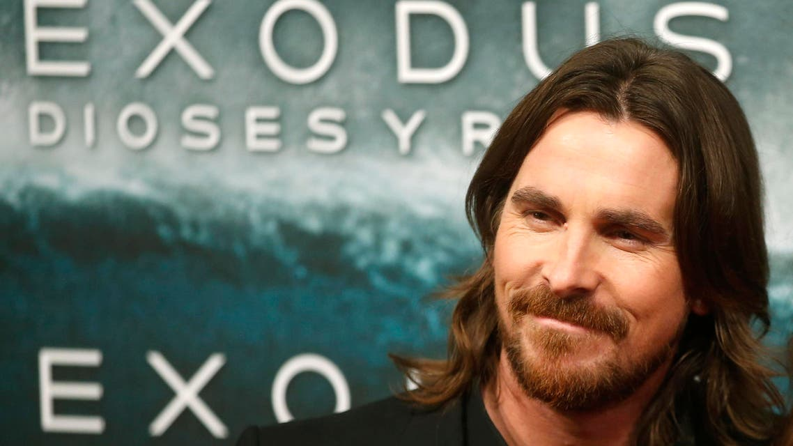 Cast member Christian Bale poses for photographs as he arrives for film world premiere of Exodus: Gods and Kings in Madrid , December 4, 2014.  (Reuters)