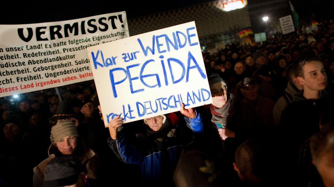 This picture taken on December 8, 2014 shows supporters of the Pegida movement, which stands for Patriotic Europeans Against the Islamification of the Occident, during a rally in Dresden, Germany. (AFP)