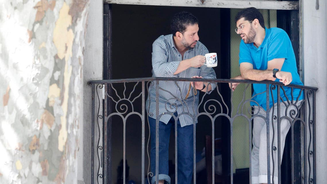 Former Guantanamo detainees Adel bin Muhammad El Ouerghi (L) from Tunisia and Omar Mahmoud Faraj from Syria talk on a balcony in a neighbourhood in Montevideo December 12, 2014. (Reuters)