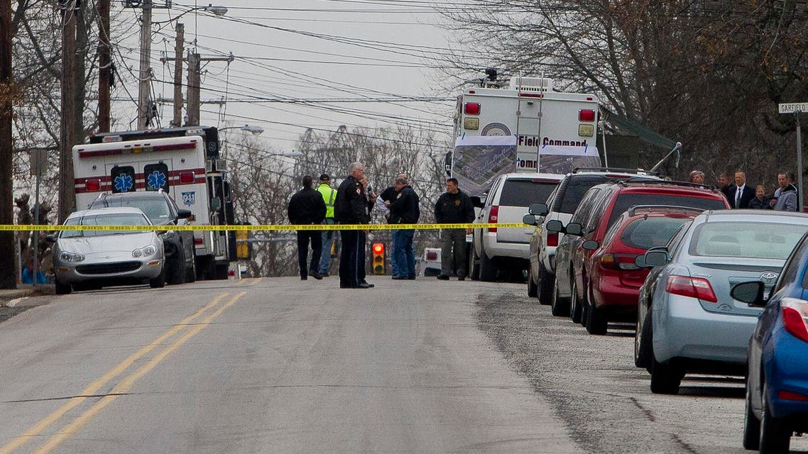 Police has the streets taped off as the search near a home in a suburb of Philadelphia where a suspect in five killings was believed to be barricaded in Souderton, Pennsylvania, December 15, 2014. (Reuters)