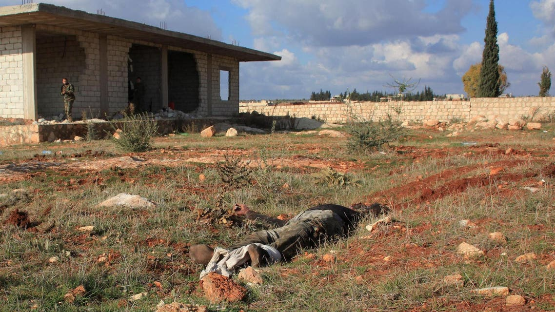 The body of an alleged rebel fighter lies on the ground during an operation by Syrian regime forces to take control of the Al-Maleh farms, west of the Handarat hill which is located just north of Aleppo, on December 15, 2014. (AFP)