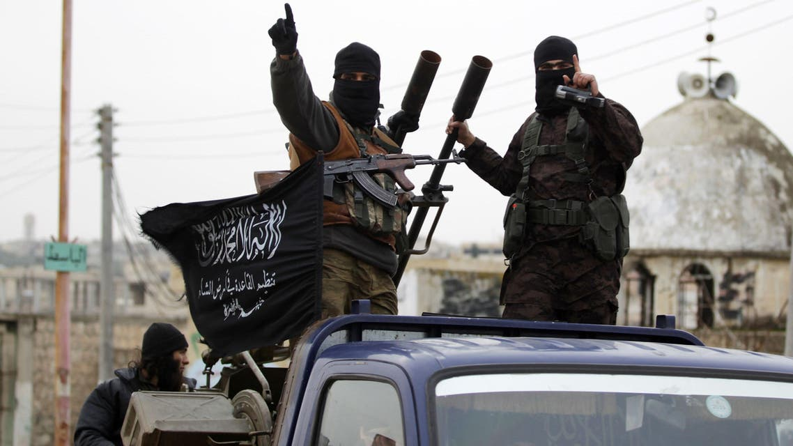 Members of al Qaeda's Nusra Front gesture as they drive in a convoy touring villages, which they said they have seized control of from Syrian rebel factions, in the southern countryside of Idlib, December 2, 2014. Reuters
