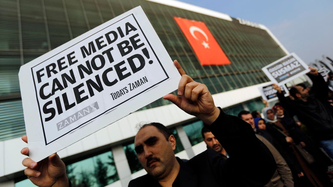 Zaman media group employees hold banners outside the headquarters of Zaman daily newspaper in Istanbul December 14, 2014. (Reuters)