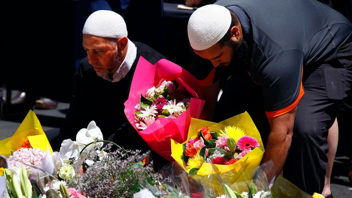 Members of the Australian Muslim community place floral tributes amongst thousands of others near the Lindt cafe, where hostages were held for over 16-hours, in central Sydney December 16, 2014. Reuters