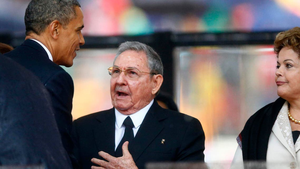U.S. President Barack Obama (L) greets Cuba's President Raul Castro (C) at the memorial service for late South African President Nelson Mandela in Johannesburg in this Dec. 10, 2013 file photo. (Reuters)