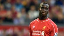 Liverpool's Balotelli gets ban, fine for Super Mario 'racist' post
