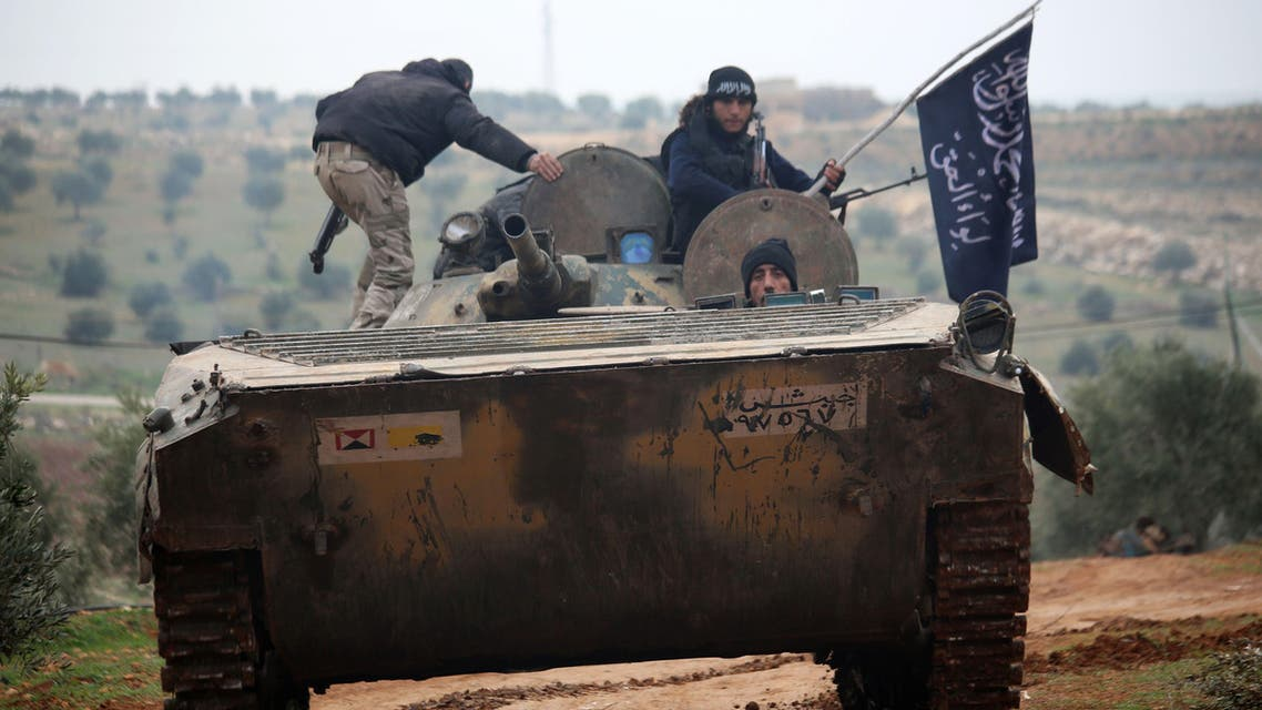 Fighters from the Al-Nusra Front, Al-Qaeda's Syria branch, drive a tank they seized from forces loyal to the regime as they fight against them on December 19, 2014 in the southern countryside of Syria's northern city of Aleppo. AFP