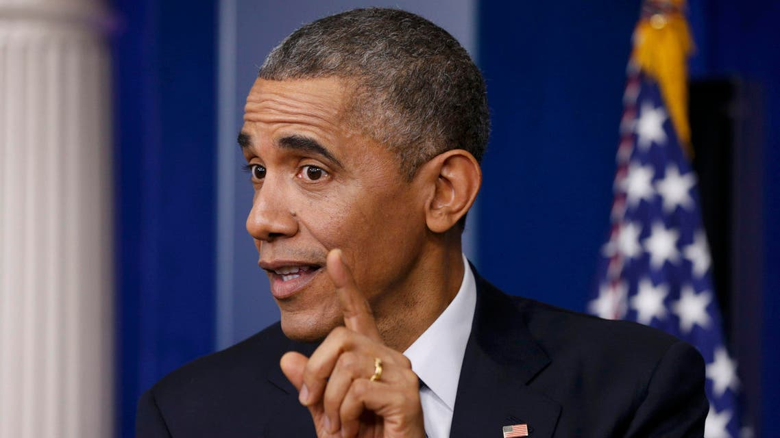 U.S. President Barack Obama gestures as he answers a question during his end of the year press conference in the briefing room of the White House in Washington, December 19, 2014. Obama and his family plan to depart Washington later in the day to spend the holidays in Hawaii. REUTERS