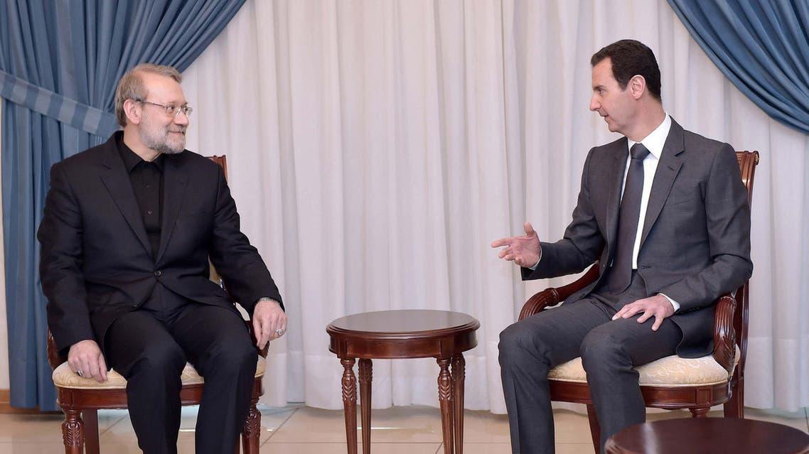 Syria's President Bashar al-Assad (R) meets Iranian Parliament Speaker Ali Larijani in Damascus December 21, 2014. (Reuters)