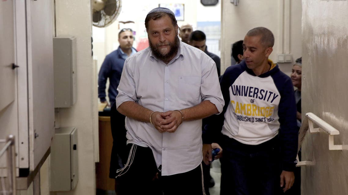 Israeli settler Benzi Gopstein, the leader of the extreme right-wing movement Lehava, is escorted out of a hearing at a Jerusalem court on December 18, 2014. (File photo: AFP)