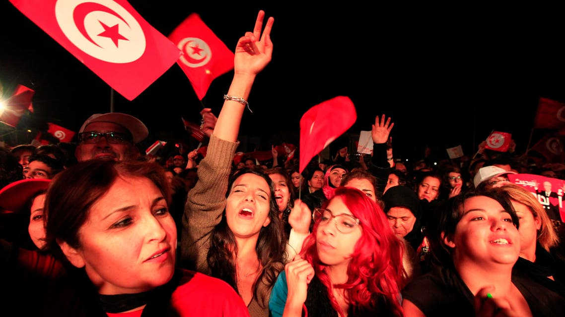 Supporters of the Nidaa Tounes (Call for Tunisia) secular party movement wave flags and shout slogans in Tunis December 21, 2014.  (Reuters)