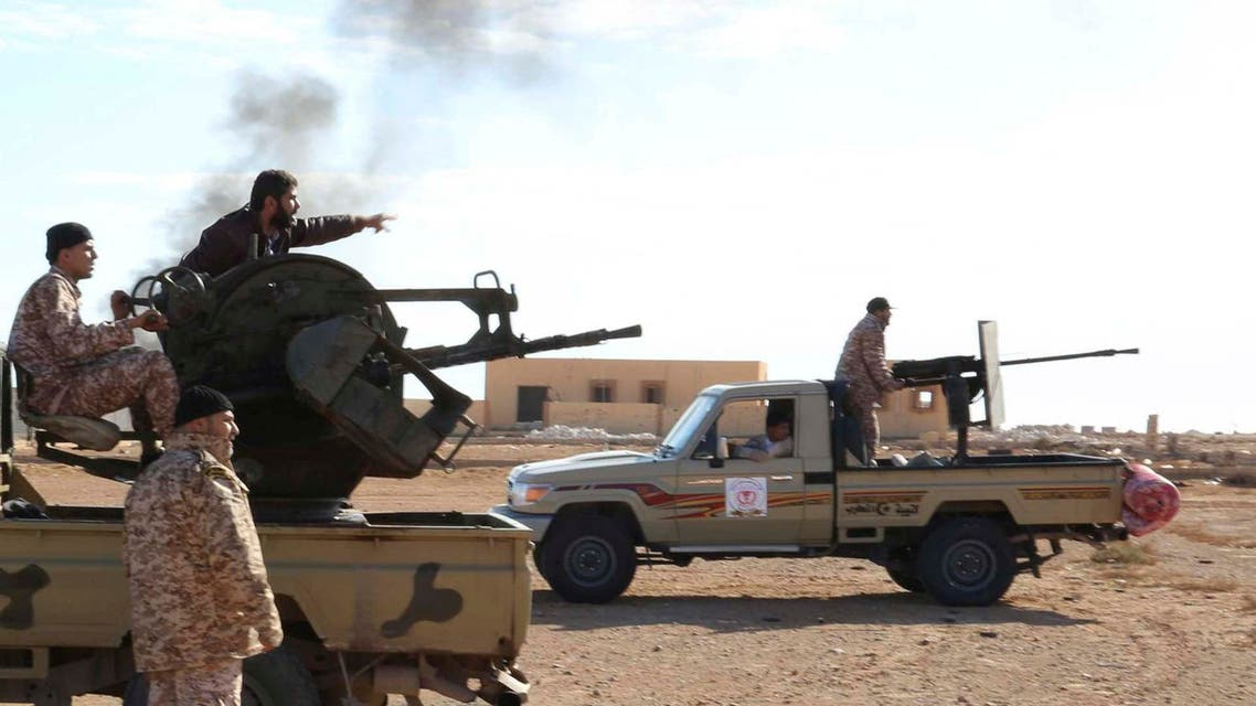 Libyan Army Forces belonging to Libya's rival government, that are part of the Alshorooq (Libya Dawn) operation to free oil ports, fire a vehicle-mounted weapon on the outskirts of Al Sidra oil port December 14 2014. (Reuters)