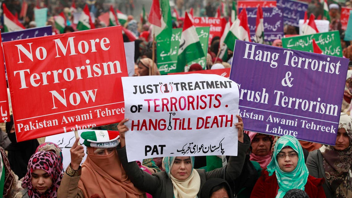 Supporters of political party Pakistan Awami Tehreek (PAT), hold signs to condemn the attack by Taliban gunmen on the Army Public School in Peshawar, during a rally in Lahore December 21, 2014. (Reuters)