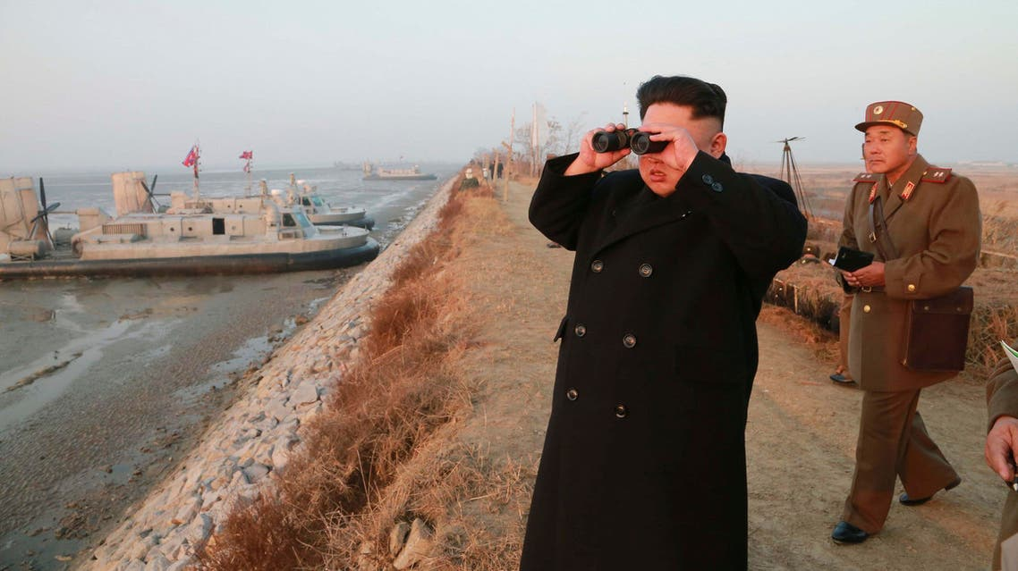 North Korean leader Kim Jong Un looks through a pair of binoculars as he organizes and guides a combined joint drill in this undated photo released by North Korea's Korean Central News Agency (KCNA). (Reuters)