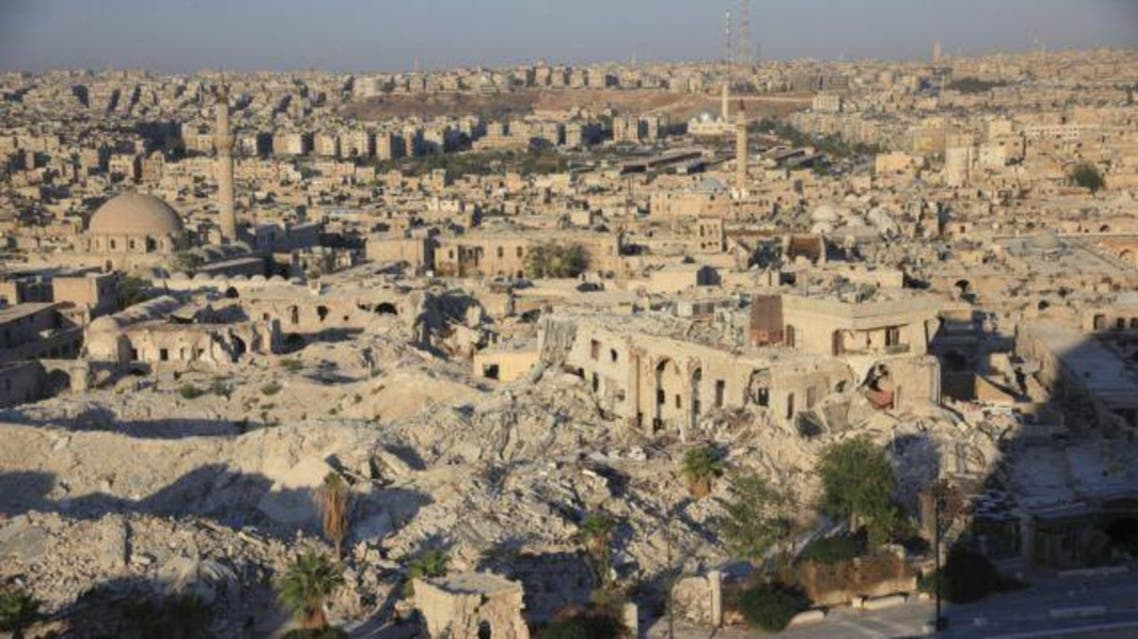 FILE - A general view shows damaged buildings and mosques around Aleppo's historic citadel, Oct. 1, 2014.
