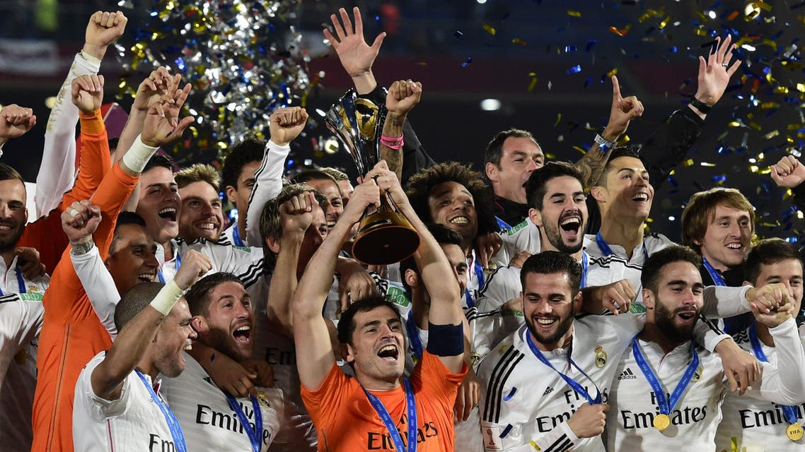 Real Madrid's players celebrate with the trophy after winning the FIFA Club World Cup final football match against San Lorenzo at the Marrakesh stadium in the Moroccan city of Marrakesh on Dec. 20, 2014. (AFP)