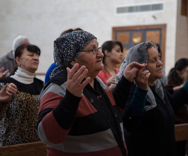 Christian Iraqi women pray during a Dec. 11 Mass at the Maronite Catholic Cathedral of the Resurrection in Rabieh, east of Beirut. (Photo courtey of Catholic News Service)