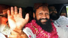 Pakistan extremist leader held for two more weeks in murder case