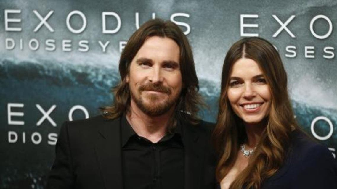 Cast member Christian Bale (L) and his wife Sibi Blazic pose for photographs as they arrive for the film world premiere of ''Exodus: Gods and Kings'' in Madrid , December 4, 2014.