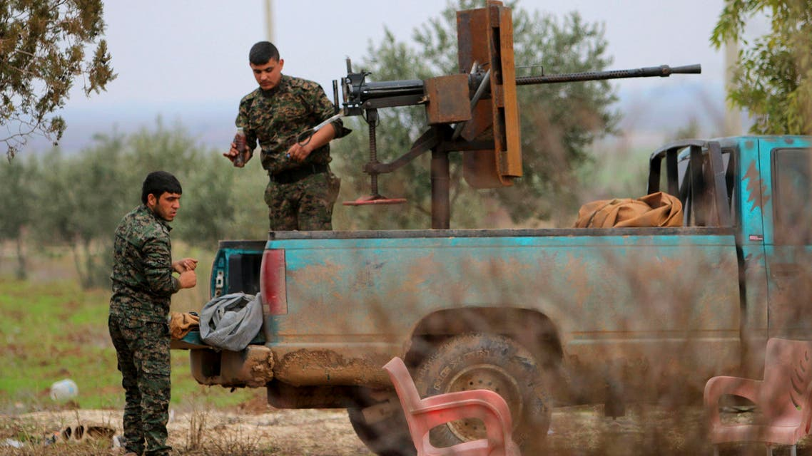 Fighters of the Kurdish People's Protection Units (YPG) manage weapons at the back of a pick-up truck in the southern countryside of Ras al-Ain December 20, 2014. Reuters