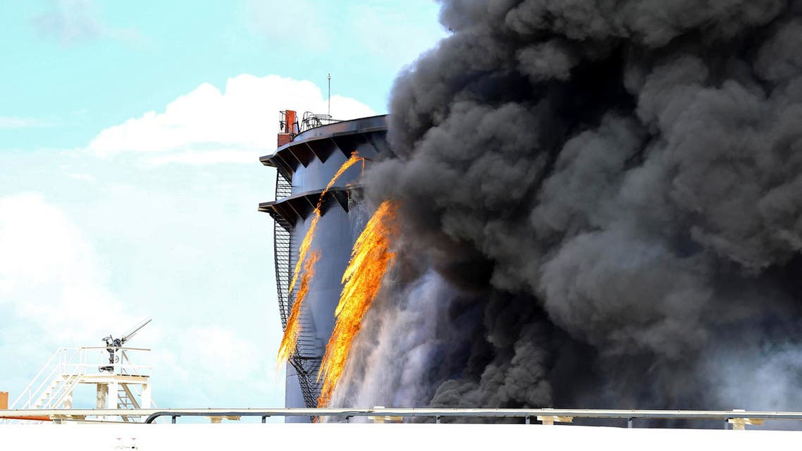 Black smoke billows out of a storage oil tank in the port of Es Sider in Ras Lanuf Dec. 25, 2014. (Reuters)