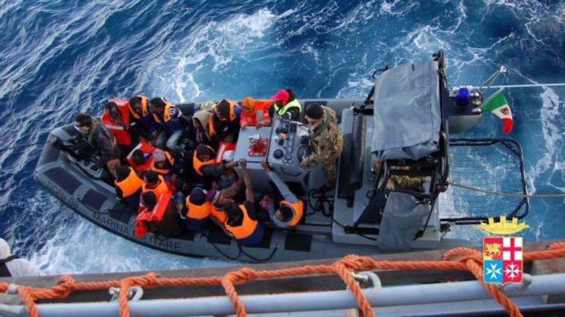 A handout picture provided by the Italian Navy Press Office shows members of the Italian Navy rescuing migrants from small boat carrying 233 people off the coast of a Sicilian island. (EPA/ITALIAN NAVY PRESS OFFICE/HANDOUT)