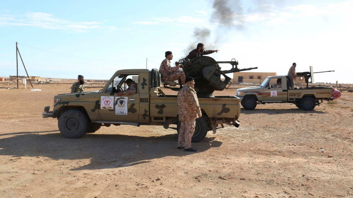 Libyan Army Forces belonging to Libya's rival government, that are part of the Alshorooq (Libya Dawn) operation to free oil ports, are seen on the outskirts of Al Sidra oil port Dec. 14, 2014. (Reuters)