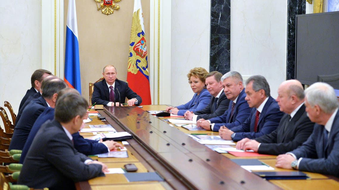 Russian President Vladimir Putin (C) chairs a Security Council meeting at the Kremlin in Moscow on Dec. 26, 2014. (AFP)