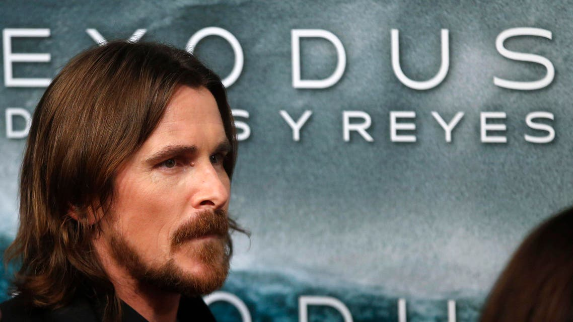 """Cast member Christian Bale poses for photographs as he arrive for the film world premiere of """"Exodus: Gods and Kings"""" in Madrid , December 4, 2014. REUTERS"""