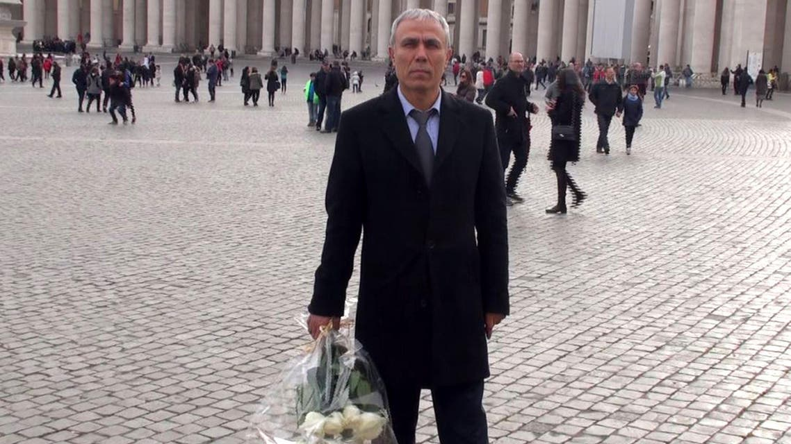 Mehmet Ali Agca, the Turkish former extremist who attempted to assassinate Pope John Paul II in 1981, holding a wreath of flowers on St. Peter's square in The Vatican. (AFP)