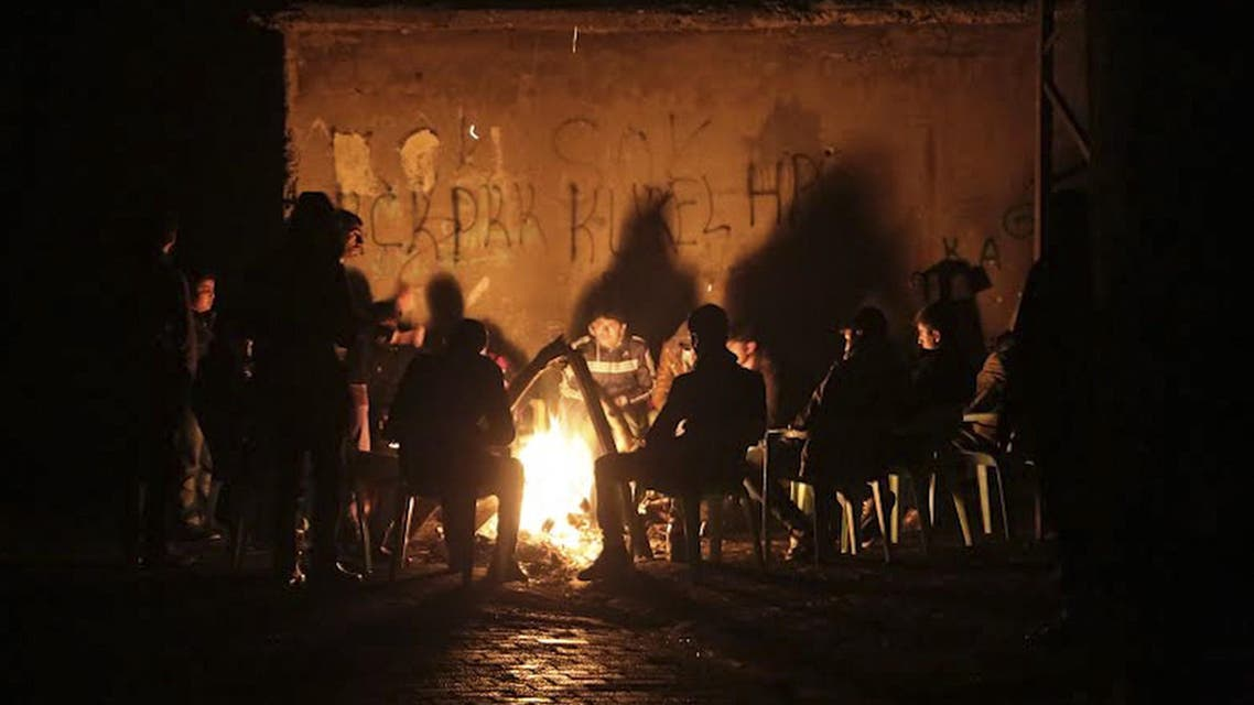 Kurdish people gather around bonfire on December 27, 2014, at Cizre in Sirnak where clashes left three killed. (AFP)