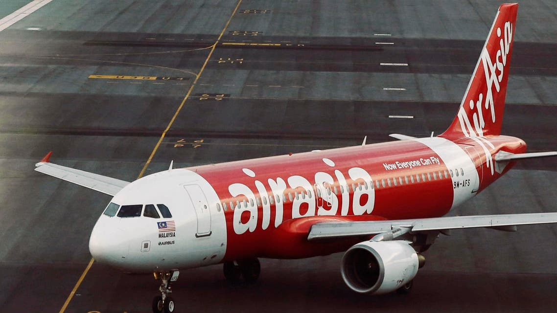 An AirAsia plane is seen on the runway at Kuala Lumpur International Airport in this August 19, 2014 file photo. (Reuters)