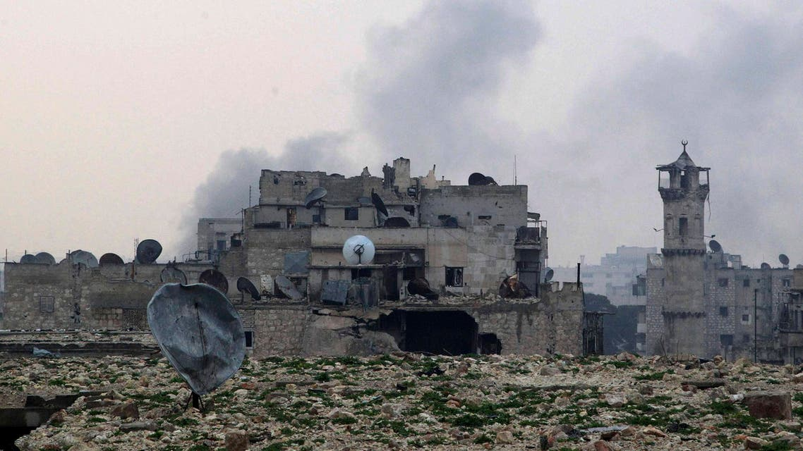 Smoke rises behind damaged buildings after what activists said was shelling by forces loyal to Syria's President Bashar al-Assad in Aleppo December 28, 2014. (Reuters)