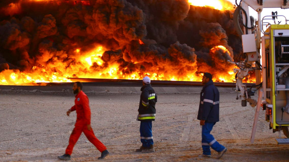 Firefighters try to put out a fire in an oil tank in Es Sider port December 26, 2014. (Reuters)