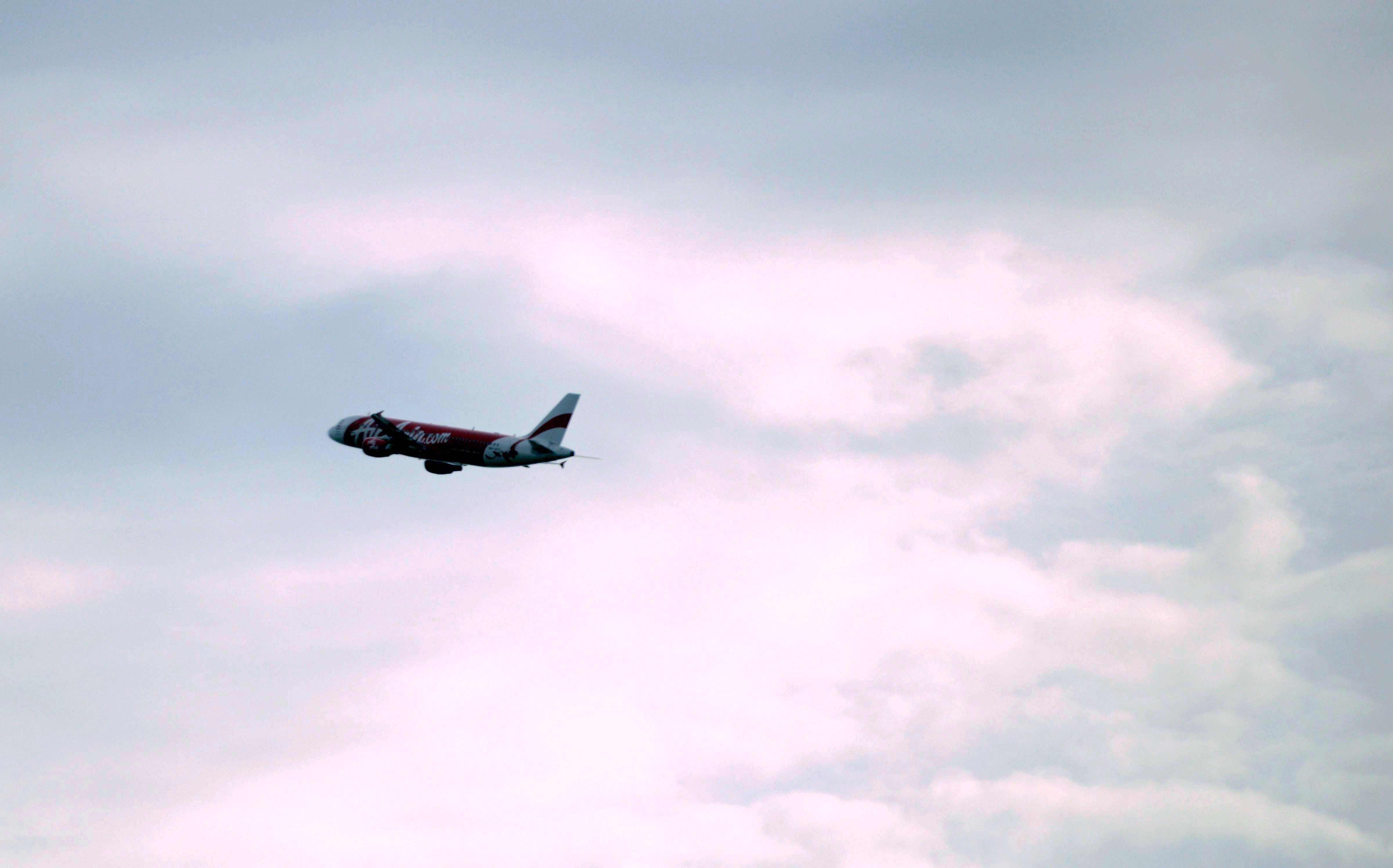 An AirAsia plane takes off from terminal 1 at Changi international airport in Singapore on December 29, 2014. (AFP)