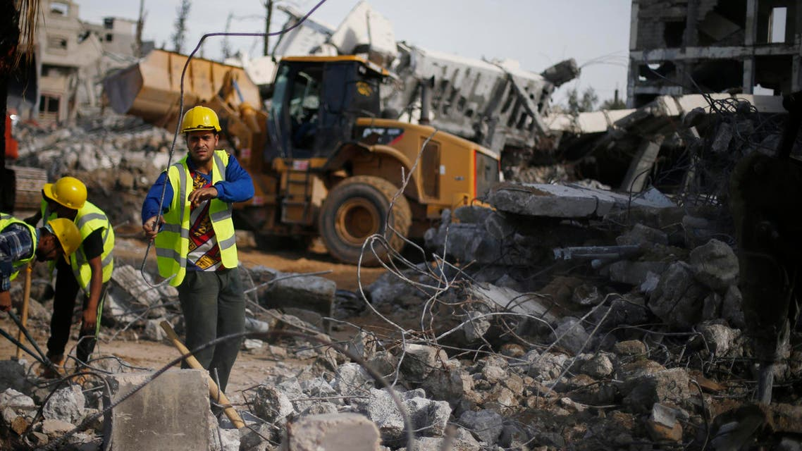 Palestinian workers participate in efforts to clear the rubble of a school, that witnesses said was destroyed by Israeli shelling during the most recent conflict in Gaza. (File photo: Reuters)
